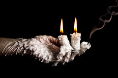 Three candle sticks on fingers buring smoulder artistic conversi Royalty Free Stock Photo