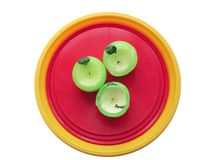 Three Candles!. On Yellow Plastic Plate Royalty Free Stock Photography
