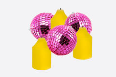 Three candles. Three yellow candles and three pink spheres for a New Year's card stock photo