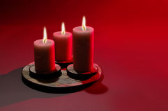 Three Candles. Over red background royalty free stock image