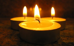 Three candles Stock Photos