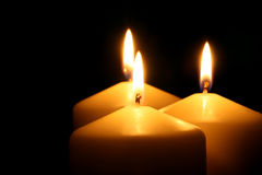 Three candles. In the dark Stock Images