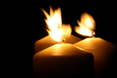 Three candles. In the wind Royalty Free Stock Photography