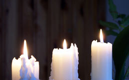 Three Candles. A set of three white candles burning in the night Stock Images