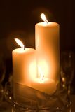 Three candles. Three white pillar candles tied with a bow Royalty Free Stock Photo