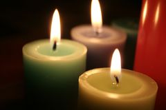 Three candles. Three colored candles, romantic evening Stock Photos