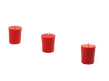 Three candles. Three red candles isolated on white background Royalty Free Stock Photography