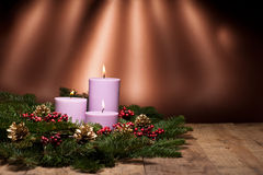 Three candles in an advent flower arrangement Royalty Free Stock Image