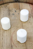 Three candles on the barrel Royalty Free Stock Image
