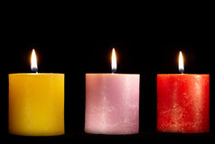 Three candles on black. Stock Images