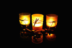 Three candles. On the black background Stock Photography