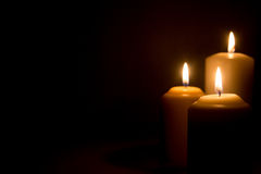 Three candles. On a black background Stock Photo