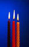 Three Candles On Blue Royalty Free Stock Image