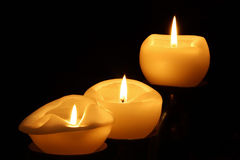 Three candles burning Stock Photo