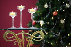 Three candles burning in candlesticks Royalty Free Stock Photos