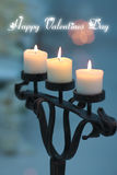 Three candles in a candlestick light valentines day love Royalty Free Stock Photography