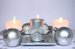 Three candles and Christmas balls Stock Photo