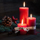 Three candles. With christmas decoration Royalty Free Stock Photos