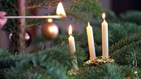 Three candles. On the Christmas tree lit stock video footage