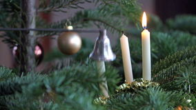 Three candles. On the Christmas tree will be deleted stock video