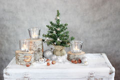 Three candles and Christmas tree. Three candles on the wooden pallets and Christmas tree Royalty Free Stock Images