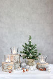Three candles and Christmas tree Stock Photos