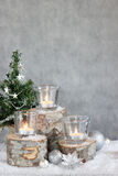 Three candles and Christmas tree Stock Images