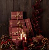 Three candles of crimson and pink color on the background of gif Royalty Free Stock Photos