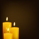 Three candles and dark background Stock Images