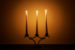 Three candles in the dark room Royalty Free Stock Photos