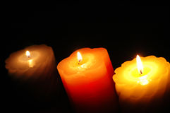 Three candles in the darkness Royalty Free Stock Photo