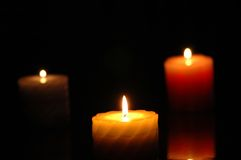 Three candles in the darkness Stock Image