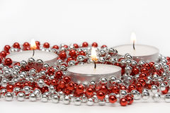 Three Candles and Decoration Beads Royalty Free Stock Images