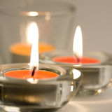 Three candles flaming Stock Photography