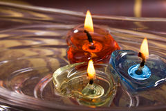 Three candles floating on water bowl Royalty Free Stock Photo