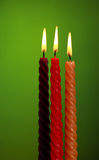 Three Candles On Green Royalty Free Stock Photo
