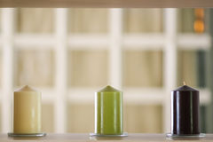 Three candles. Home decoration with three candles in a row Stock Images