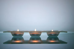 Three candles light Stock Photos