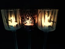 Three candles in a row royalty free stock photo