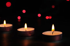 Three candles. At night with red light Stock Image