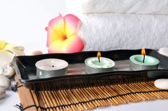 Three candles in plate Royalty Free Stock Images