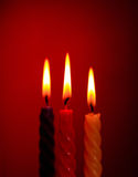 Three Candles On Red Royalty Free Stock Photo