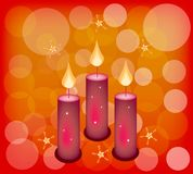 Three Candles on A Red Abstract Background Stock Photos