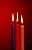 Three Candles On Red Royalty Free Stock Photos