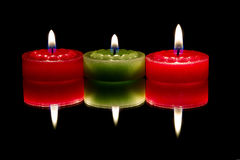Three candles, reflected Stock Photo