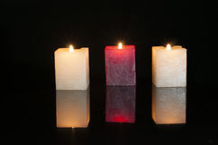 Three Candles with reflection Royalty Free Stock Image