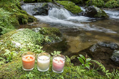 Three candles at riverside Stock Image