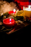 Three candles. Still life with candles with rose leaves Stock Photo