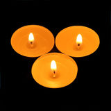 Three candles triangle Stock Images