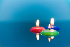 Three candles in water Stock Image